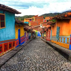 Colombia travel at its finest - The beautiful town of Guatape in Colombia with it's colourful streets The Places Youll Go, Cool Places To Visit, Places To Travel, Colombia South America, South America Travel, Travel Around The World, Around The Worlds, Guatemala, Colombia Travel