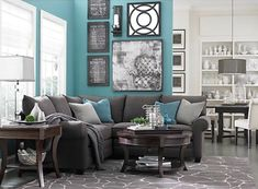 Turquoise wall with black/white photos