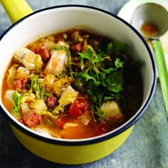 Portuguese Fish Stew Ingredients 3  plum tomatoes  7 ozs  savoy cabbage (outer leaves removed)  2 tbsps  extra virgin olive oil  7 ozs  chorizo sausage ((cooked or uncooked), skinned, and cut into chunks)  2 lbs  new potatoes (peeled and cut into 1/2 inch dice)  1/2 cup  white wine  6 cups  fish stock  2 lbs  fish fillets (mixed, skinned and cut into 1-inch pieces)   chopped cilantro (extra virgin olive oil and, for serving)   extra virgin olive oil (and coarsely chopped cilantro, for…