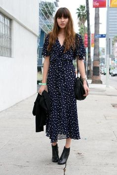 Natalie Off Duty in a printed navy dress and black booties