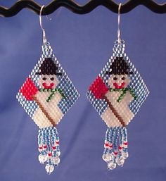 Snowman with Shovel Earrings by handmadebyartie on Etsy, $20.00  Free shipping.