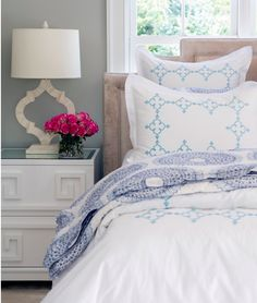 House Tour: Saugatuck Shores |  From the lacquered nightstand to the bone lamps, every element of this bedroom is tasteful and lovely.