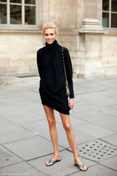 Anja Rubik in a relaxed little black dress #LBD BUT, sweater looks silly with flip flops. Def with boots! Luv