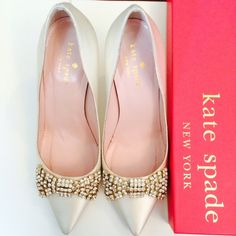 "✨Kate Spade Pezz Ivory Satin Crystal Bridal Pumps ✨HP 11/6✨My wedding shoes! Worn only once :) Super cute bow on top of delicate ivory satin shoes. so so gorgeous. It even comes with a little special ""something blue"" on the bottom ;) This kate spade new york pump spotlights bridal style with ivory satin and a sparkling crystal bow. 3.75"" covered stiletto heel. Pointed toe with crystal bow detail. Padded leather footbed. Leather lining and sole. made in Italy. These run large. I'm typically…"