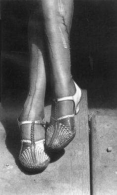 A Sign of the Times - Depression - Mended Stockings, Stenographer, San Francisco, 1934 by Dorothea Lange