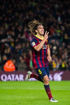 Carles Puyol celebrates after scoring his team's third goal during the La Liga match between FC Barcelona and UD Almeria at Camp Nou on March 2, 2014 in Barcelona, Catalonia.