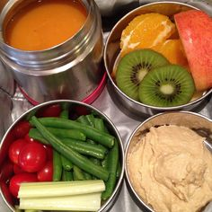 A thermos of warm sweet potato and #apple soup along with raw #celery, cherry tomatoes and steamed green beans, hummus, apples, oranges and kiwis make for a nourishing lunch. When I don't have time to make hummus, our go-to is the roasted garlic and onion one from Sunflower Kitchen. Yummy!