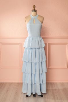 Anamika #Boutique1861 / This long pale blue gown combines sophistication with fun as it pairs a fitted bodice with a layered frill skirt. The keyholes at the front and back show off a little more skin for a summer feel. Dance the night away in this dress that will move with every twist and turn you make! #promdresses #pastel