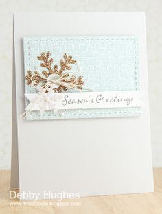 Inlayed snowflake and stitched border die. Very subtle and elegant.