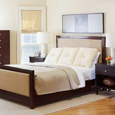 Modern Neutrality      Matching furniture pieces create a cohesive presentation in this room's interior. Simple beige bedding matches the upholstered headboard and footboard, while the muted blue artwork takes the spotlight.        What We Love: Large square chair cushions are perfect when you want a more modern look in your bedroom.
