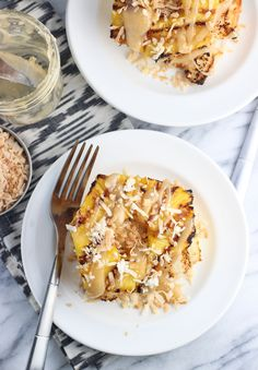 Grilled angel food cake slices are stacked high with grilled pineapple slices, toasted coconut flakes, and a drizzle of caramel sauce for a tropical…