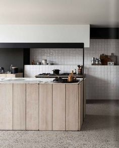 Modern kitchen interior with white tiled walls, marble tops and wooden island. Kitchen Dinning, New Kitchen, Kitchen Decor, Rustic Kitchen, Kitchen Tiles, Dining, Kitchen Flooring, Kitchen White, Kitchen Island