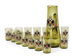 Emperor Franz Joseph I. of Austria - carafe and 14 cups for the Emperor's jubilee 1898, green glass, wall with opaque painted imperial double eagle, slogan Viribus Unitis and year 1848-1898, golden lip, height of carafe 33 cm, height of cups 11 cm, 1898.