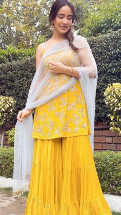 Spotted actor Neha Sharma in our Sarina ochre hand embroidered kurta with tired sharara pant and dupatta. Party Wear Indian Dresses, Designer Party Wear Dresses, Indian Gowns Dresses, Indian Bridal Outfits, Indian Fashion Dresses, Dress Indian Style, Pakistani Dresses, Prom Dresses, Sharara Designs