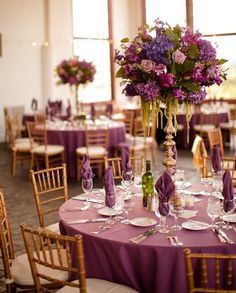 purple wedding decorations - I like the style of the centerpiece for bouquets, a bit airy but contained?