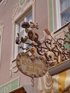 Antique shop sign in Garmisch-Partenkirchen, Bayern, Germany photography by cityhopper2