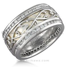 Mokume Vine Overlay Wedding Band with Two Diamond Channels - This custom mokume wedding band features a platinum vine overlay pattern atop mokume and two diamond channels. The scrolling vine adds a touch of delicacy and romance to this ring. It has a slightly rounded profile. Set with ideal cut diamonds.