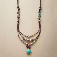 "COMPENDIUM NECKLACE -- Our handcrafted leather, sterling bead and gemstone necklace is a compendium of colorful gems and sterling silver beads, bedecking a leather cord. A handmade exclusive with turquoise, garnets and more. Slide adjusts length from 18"" to 28""L."