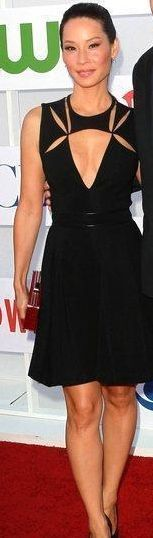 Lucy Liu in a black cutout dress with a plunging neckline