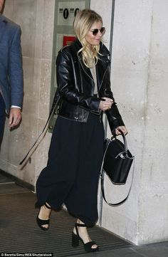 Sienna Miller (with Louis Vuitton bag, Prada shoes) - Leaving the BBC Radio One Studios in London.  (13 January 2017)