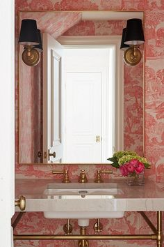 create a chinoiserie chic aesthetic in a bathroom by decorating with pink toile wallpaper and accompanying vintage-inspired brass accents Pink Toile Wallpaper, Antique Wallpaper, Bathroom Wallpaper Trends, Glass Wine Cellar, Dallas, Bathroom Red, Bathroom Ideas, Spa Bathrooms, Brass Bathroom