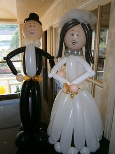 Life-size bride & groom balloon couple welcoming guests at program ...