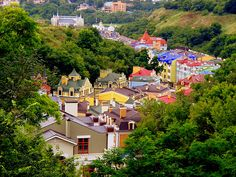 Kiev, Ukraine. Love the contrast of the colours of the houses to the surrounding trees.
