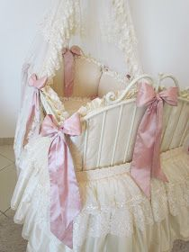 This sweet baby bed is covered with silk on the outside    and cotton on the inside.         This bed is a good size for a newborn baby u...
