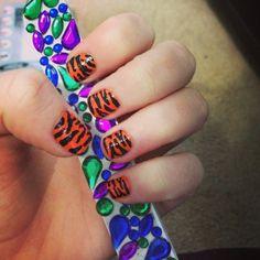 Tiger print nails done with nail pens