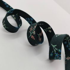 double fold geometric flower on turquoise CHOOSE 38 or 12 wide 3 yards bias tape