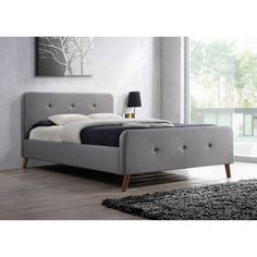 An aesthetically pleasing bed that is incredibly stable and comfortable, the Laurio fabric upholstered bed features mid-century retro modern design.
