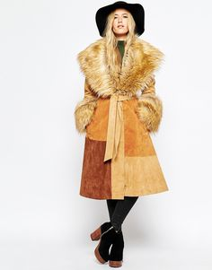 The most vintage looking non vintage coat I have ever seen. That faux fur collar, that suede patchwork, I'm head over heels in love.