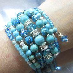 "This is the"" Glamorous Ocean Blue Mermaid Memory Wrap Bracelet"" This fantastic ocean blue mermaid cuff is an artisan made 7 loop memory wire wrap bracelet cuff that is loaded with lots of 10mm, 8 mm,"