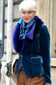 Elisa Nalin adds even more plush to her velvet jacket with a cobalt blue collar.   - ELLE.com