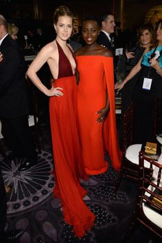 Amy Adams and Lupita Nyong'o were visions in red at the Golden Globes.