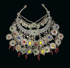 Balochistan (Iran, Afghanistan, Pakistan): A necklace made of silver, coins and colourful glass stones.