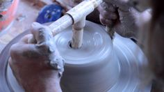 This short clip shows a simple effective tool for opening a ball of clay that creates a bottom of even thickness.