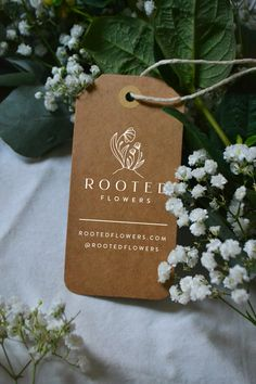 Packaging details for Rooted Flowers - tag, hang tag, kraft, white ink, flower farm, floral, bouquet, flower wrap, packaging, elegant, delicate, feminine, local, sustainable, eco-friendly, recyclable, bridal, botanical