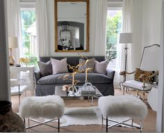 Mixed metals, modern & traditional, cheetah print, fur on stools, layered hide rug.  Home of designer Sally Wheat.