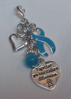 "Teal awareness purse pull with open heart accent and ""together we can make a difference"" charm!"