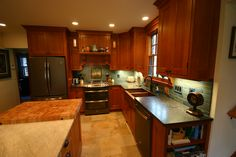 Open Concept Kitchen, Large Kitchen Island, Breakfast Nook, Large tile floor, china hutch, bead board ceiling, Copper farmers sink, peninsula island seating, warming drawer, butcher block counter top,
