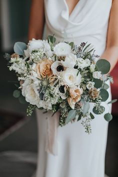Bright and organic white, peach, and green bridal bouquet with poppies, peonies, and roses | Image by Rachel McCauley Photography