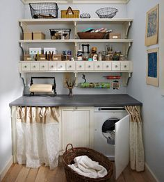 """Craft Supply Station - A crafts station can be hung on any wall in the house, even above a washer and dryer. Open shelves accommodate oddly shaped supplies, such as a sticker maker and floral arrangement containers. Small drawers hold notions, embellishments, and small tools while keeping the space uncluttered."""