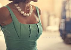 """pleat love on the bodice design and the chunky """"pearl"""" necklace"""
