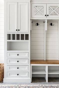 Mudroom Cabinet Dropzone Mudroom Cabinet Dropzone The mudroom upper cabinets are inset with antiqued mirror Mudroom Cabinet Ideas Dropzone Mudroom Cabinet #Dropzone #Mudroom #Cabinet Laundry Room With Cabinets, Laundry Room Doors, Mudroom Cabinets, Mirror Cabinets, Mud Room Lockers, Laundry Room Design, Laundry Shelves, Garage Entry, Front Entry