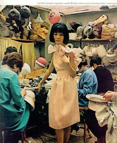 Japanese model Hiroko doing a fitting at Pierre Cardin's workshop before a fashion show in the mid 60s.