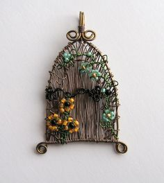 Fairy Door wire wrapped pendant with flowers by LouiseGoodchild,