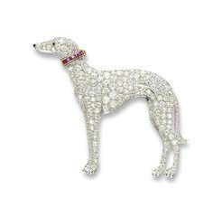 A STYLISH ART DECO DIAMOND, RUBY AND ONYX BROOCH. Designed as a greyhound, set…