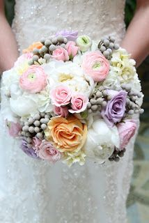 Bridal bouquet with blush, lavender, peach white and silver brunia berries.