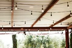 Tin ceilings and string lights would be my ultimate basement ceiling solution! Tin ceilings and st Edison Lighting, Patio Lighting, Edison Bulbs, Screened In Porch, Porch Swing, Porch Roof, Porch Ceiling, Metal Ceiling, Outdoor Spaces